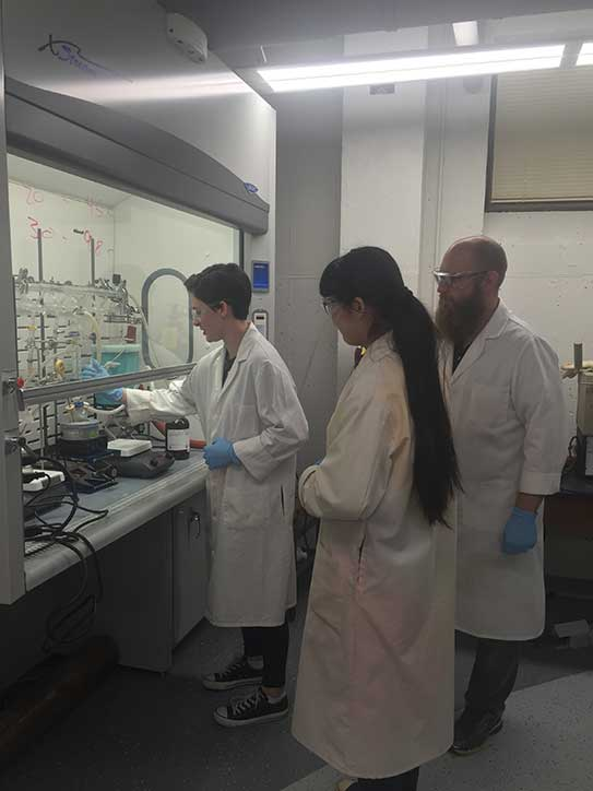 Sam Ayala '19, Yaqi Song '17, and professor Matt Becker work in new laboratories in Science Hall.