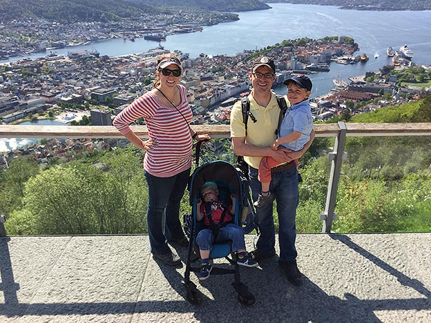 The Newcamp family standing on a hill overlooking the port city of Bergen, Norway