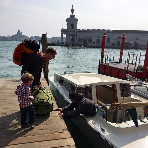 The Newcamp family boards a boat in Venice