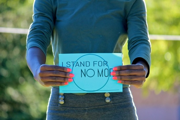 "Student holding sign which reads ""I stand for no more."""