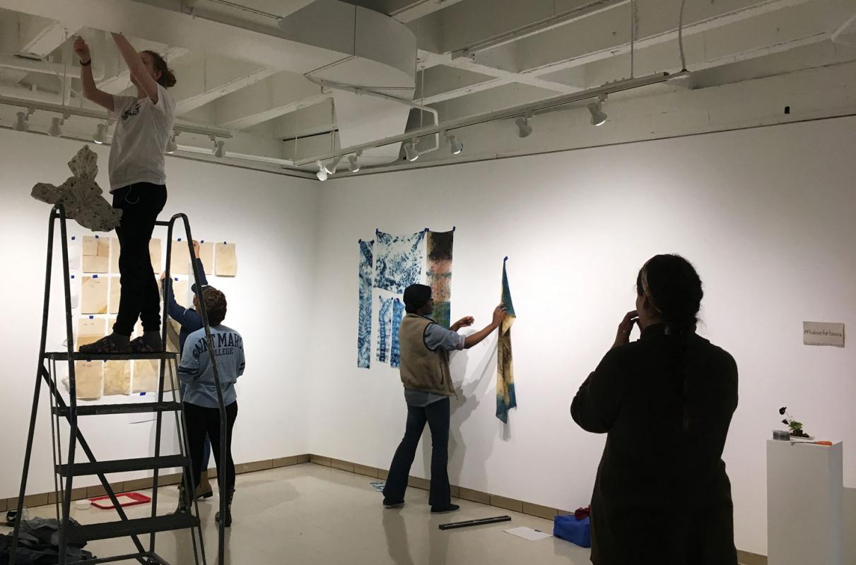 Students in Sustainable Textiles course install their work in the art gallery