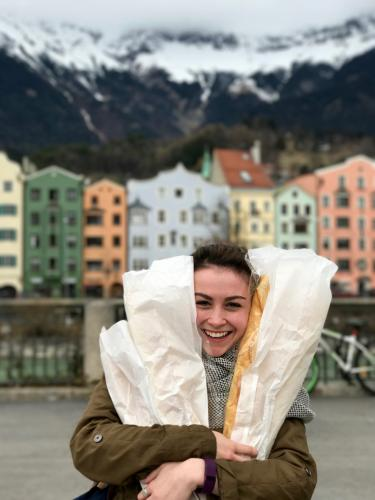 Meredith Kisla in front of the iconic colorful buildings in Innsbruck. Gluten tag!