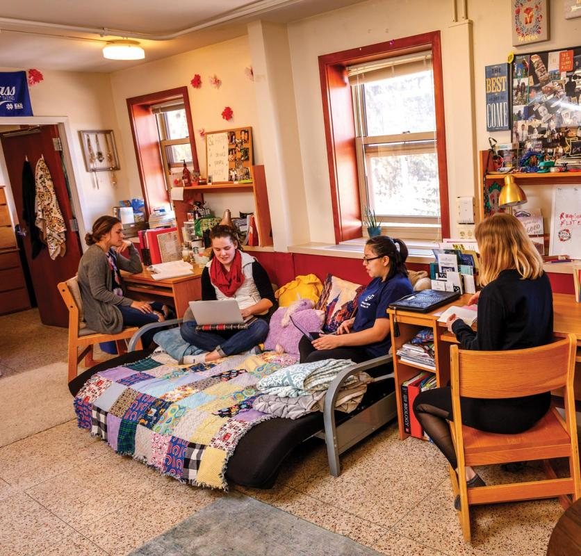 Students lounging in their room in Regina.