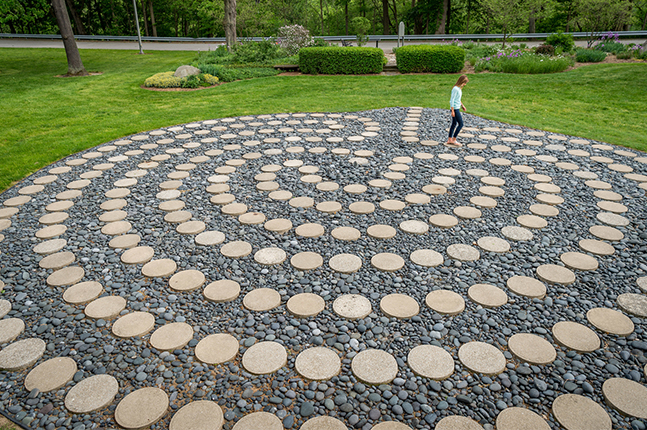 A student walks the campus labyrinth