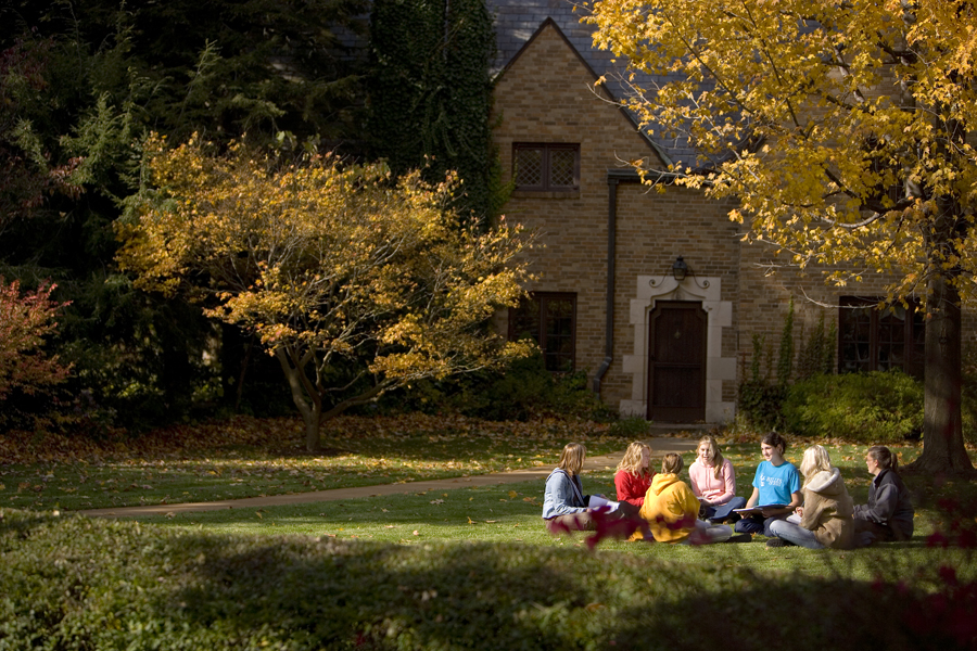 Students studying outside on Saint Marys beautiful campus.
