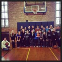 Basketball players participating in special olympics basketball clinic
