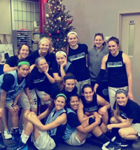Basketball players in front of Christmas tree