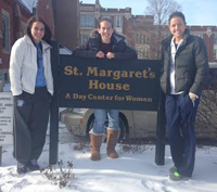 Basketball players standing in front of St. Margarets House