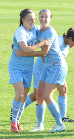 Rosie Biehl (left) and Kerry Green celebrate Biehl's goal.
