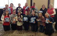 Lacrosse players with wrapped gifts for Seniors