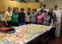 Soccer Players decorating cookies for bake sale