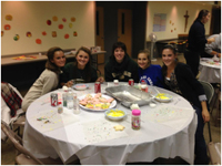 Tennis players decorating cookies