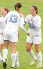 Mollie Valencia (22) celebrates her goal with Emily Rompola (13).