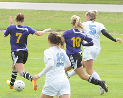 Maggie Wenzel (5) sends her game-winning shot to goal.