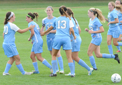 The Belles celebrate Kelly Wilson's (second from left) goal.