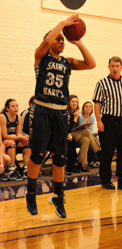 Shanlynn Bias makes a three-pointer in the final minute of play at Albion.