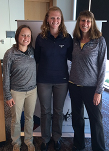 Ashley Steffey, Katie Bourbonnais, and Julie Schroeder-Biek pose for a photo at the NCAA Headquarters.