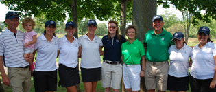 Members of the golf team take a photo with tournament beneficiaries Katie '08, Diane, and Tim O'Brien.