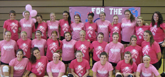 Both teams pose for a photo before Wednesday's Dig for the Cure match.