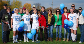 The senior soccer players and their parents were recognized at halftime of the Belles' game on Saturday.