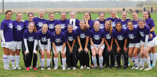 Members of the soccer team show their support for the Belles Against Violence Office and Domestic Violence Awarness Month.
