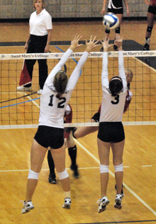 Allison Zandarski (12) and Taylor Etzell (3) go up for a block on Wednesday evening.