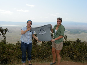 Annie Doyle and Kelley Murphy show off a Saint Mary's basketball t-shirt above ## Crater in Tanzania.