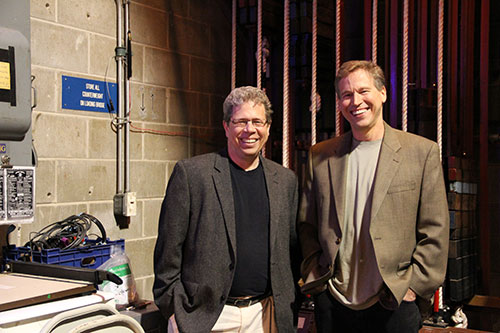 Saint Mary's College professors Mark Abram-Copenhaver and Bill Svelmoe pose backstage at O'Laughlin Auditorium on campus.