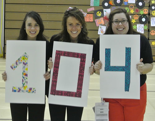 "Dance Marathon Vice Presidents Alyssa Vinluan '13 and Kate Kellogg '13 and President Amy Tiberi '13 hold up ""104"" as in ""$104,374.83 this year."
