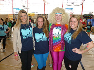 """Rock of Ages"" was the theme of this year's event. From left to right are Stephanie Gehring '13, Meghan Cronin '13, Brigid Hurley '13, and Emily Veihmeyer '13."