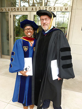 Professors Stacy Davis and Marc Belanger pose for a photo following Honors Convocation. Davis was honored with the Maria Pieta Award and Belanger received the Spes Unica Award that afternoon.
