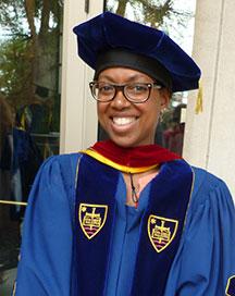 Stacy Davis, chair of the Department of Gender and Women's Studies and associate professor of religious studies, is the 2015 Maria Pieta Award recipient.