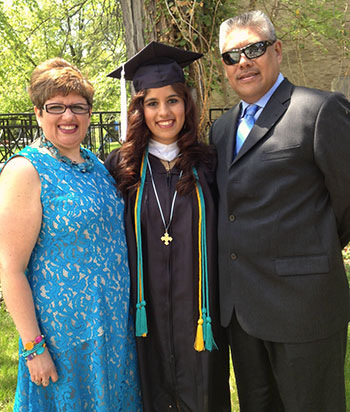 Lumen Christi Award recipient Galicia Guerrero '14 poses with her parents Gelsy and Gonzalo Guerrero.