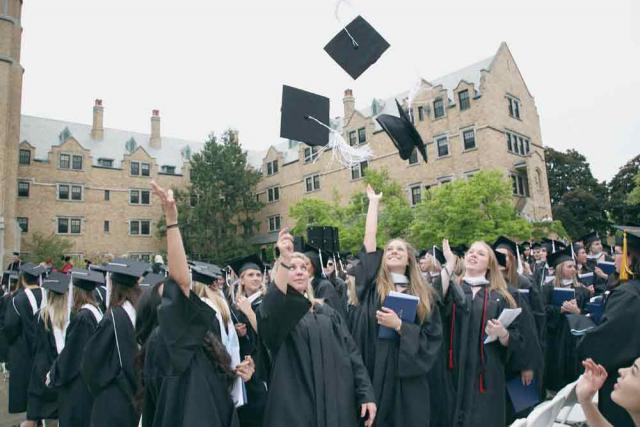 graduates tossing caps at commencement