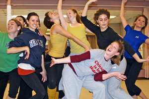 group of dance students posing with arms out