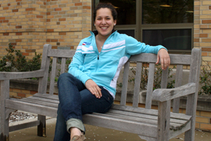 hoffman sitting on a bench on campus