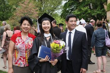 Jingqui Guan '11 poses with her parents, who came all the way from Chengdu, China to attend Commencement.