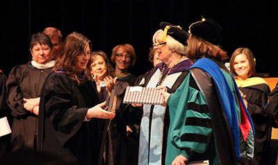 Julie Storme, professor of modern languages and interim associate dean of faculty, is honored with the Spes Unica Award at Honors Convocation.