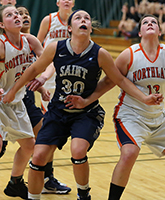 Krista Knapke looks to pull down a rebound. (Photo credit: Larry Radloff, d3photography.com)