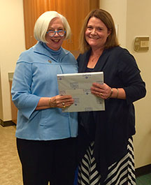 Susan Latham, associate professor of communicative sciences and disorders, right, poses with President Mooney.