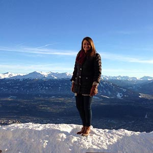 Michelle stands on top of the Nordkette Mountain in Innsbruck, Austria.