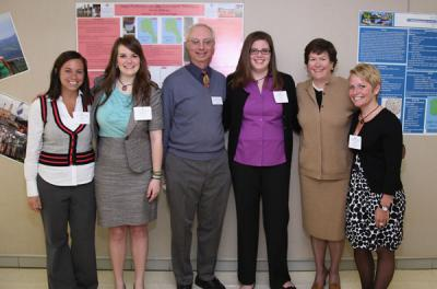 "Ashley Cook '11, Chelsea Crane '11, Professor Tom Fogle, Emma Hoffman '11, Mary Burke '85, and Megan Weinandy '11 pose together at the ""Celebrating the Education of Women in Science"" event at the College on March 26, 2011."
