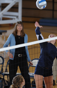 Julie Schroeder-Biek watches the action during the 2008 volleyball season.