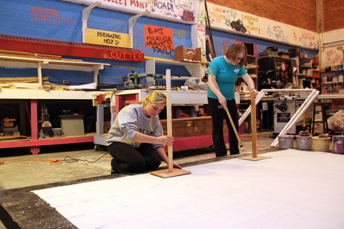 Students work on part of the new Madrigal Dinners set.