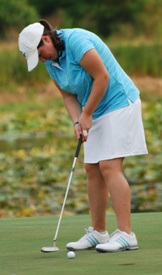 Mary Kate Boyce watches her putt before it falls for par on the 15th hole.