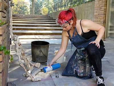 Mary Bevilacqua uses a torch on one of her art projects.