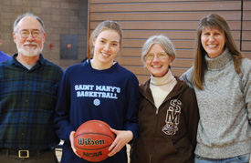 Patsy Mahoney was given the game ball with which she scored her 1,000th point before the start of the Belles' win.