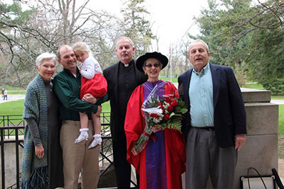 Phyllis Kaminski, center, poses with her brothers, the Rev. Frank Kaminski, S.J., and Paul F. Kaminski, far right. On the left is Paul's wife, Barbara, as well as Mia Kaminski and her dad (Phyllis' nephew) David Kaminski.