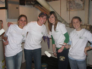 Saint Mary's students participate in Rebuilding Together by painting the interior of a home.