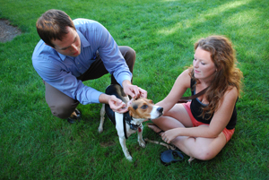 Veterinarian Dr. Rob Memmen of Morris Animal Hospital met the students' pets and made sure their shots are up to date. Here he gives Kelly the beagle a quick exam as Kelly's owner and roommate Meghan O'Rourke, r